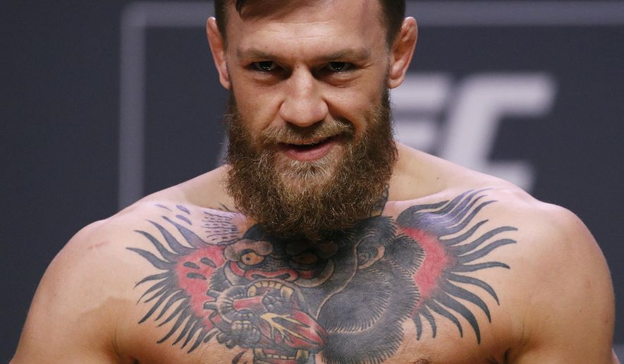Conor McGregor poses during a ceremonial weigh-in for the UFC 229 mixed martial arts fight Friday, Oct. 5, 2018, in Las Vegas. McGregor is scheduled to fight Khabib Nurmagomedov Saturday in Las Vegas. (AP Photo/John Locher)