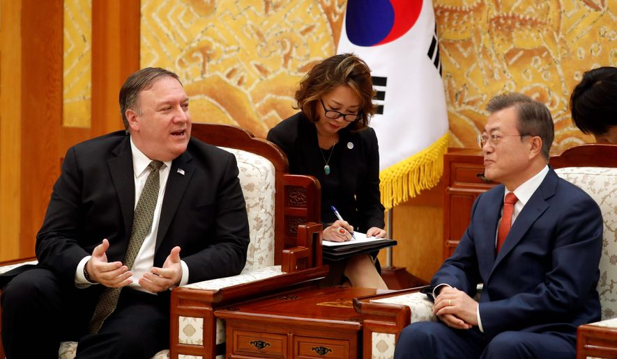 Secretary of State Mike Pompeo spoke with South Korean President Moon Jae-in at the presidential Blue House in Seoul on Sunday. Mr. Moon inquired but received no specifics about Mr. Pompeo's meeting with North Korean leader Kim Jong-un. (Associated Press)