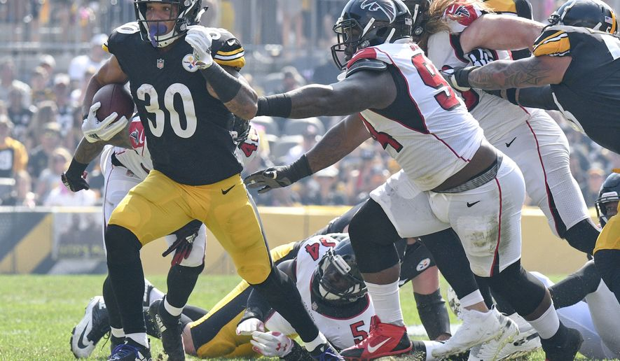 Pittsburgh Steelers running back James Conner (30) runs against the Atlanta Falcons in the first quarter an NFL football game against the Atlanta Falcons, Sunday, Oct. 7, 2018, in Pittsburgh. (AP Photo/Don Wright) ** FILE **
