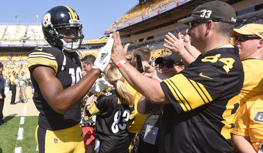 33801f09cb9 Pittsburgh Steelers wide receiver JuJu Smith-Schuster (19) greets fans on  the sideline