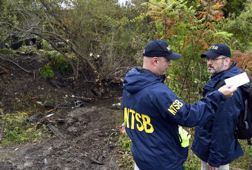 Members of the National Transportation Safety Board work at the scene of a fatal crash, in Schoharie, N.Y., Sunday, Oct. 7, 2018. (AP Photo/Hans Pennink) ** FILE **