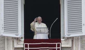 Pope Francis blesses the crowd as he recites the Angelus noon prayer from the window of his studio overlooking St.Peter's Square, at the Vatican, Sunday, Oct. 7, 2018. (AP Photo/Alessandra Tarantino)