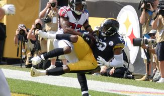 Pittsburgh Steelers wide receiver JuJu Smith-Schuster (19) makes a catch for a touchdown as Atlanta Falcons cornerback Robert Alford (23) defends in the first half of an NFL football game Sunday, Oct. 7, 2018, in Pittsburgh. (AP Photo/Don Wright)