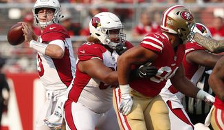 Arizona Cardinals quarterback Josh Rosen, left, passes against the San Francisco 49ers during the second half of an NFL football game in Santa Clara, Calif., Sunday, Oct. 7, 2018. (AP Photo/Tony Avelar)