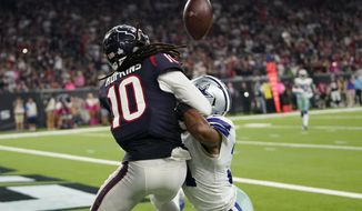 Dallas Cowboys cornerback Byron Jones, right, breaks up a pass in the end zone intended for Houston Texans wide receiver DeAndre Hopkins (10) during the second half of an NFL football game, Sunday, Oct. 7, 2018, in Houston. Defensive interference was called on the play. (AP Photo/David J. Phillip)