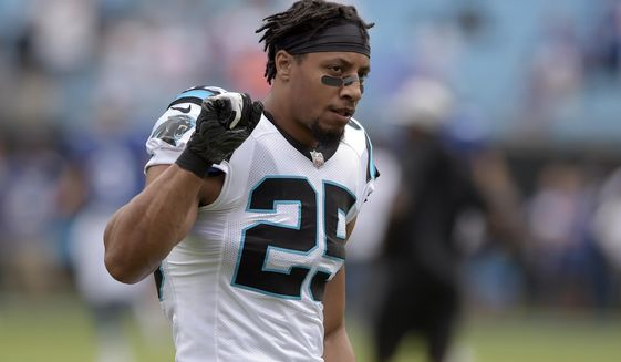 Carolina Panthers' Eric Reid (25) takes the field before an NFL football game against the New York Giants in Charlotte, N.C., Sunday, Oct. 7, 2018. (AP Photo/Mike McCarn)