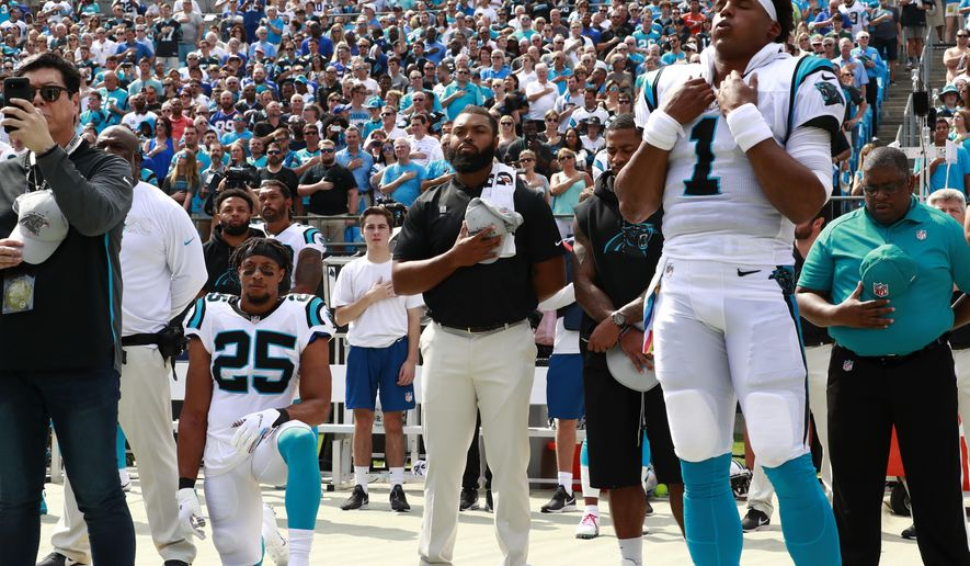 Carolina Panthers' Eric Reid (25) kneels as Cam Newton (1) stands during the national anthem before an NFL football game against the New York Giants in Charlotte, N.C., Sunday, Oct. 7, 2018. (AP Photo/Jason E. Miczek) **FILE**