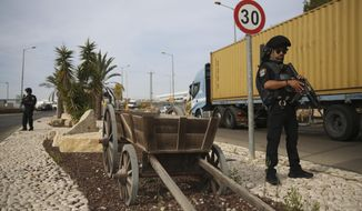 Israeli policemen stand at then entrance of Barkan industrial zone in the West Bank Sunday, Oct. 7, 2018. A Palestinian attacker opened fire at a joint Israeli-Palestinian industrial zone in the West Bank Sunday, killing two Israelis and seriously wounding a third, the military said. (AP Photo/Oded Balilty)