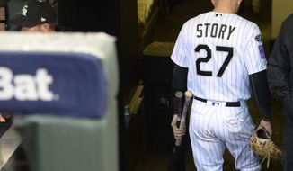 Colorado Rockies shortstop Trevor Story heads down the stairs to the clubhouse after Game 3 of a baseball National League Division Series against the Milwaukee Brewers Sunday, Oct. 7, 2018, in Denver. The Brewers won 6-0 to sweep the series in three games and move on to the National League Championship Series. (AP Photo/Joe Mahoney)