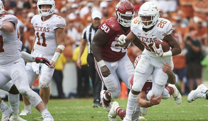 Texas running back Keaontay Ingram (26) breaks free against Oklahoma during the second half of an NCAA college football game at the Cotton Bowl, Saturday, Oct. 6, 2018, in Dallas. (AP Photo/Cooper Neill)