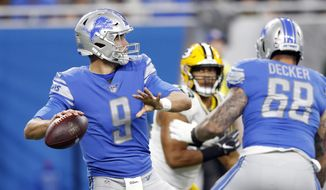 Detroit Lions quarterback Matthew Stafford prepares to throw during the first half of an NFL football game against the Green Bay Packers, Sunday, Oct. 7, 2018, in Detroit. (AP Photo/Carlos Osorio)