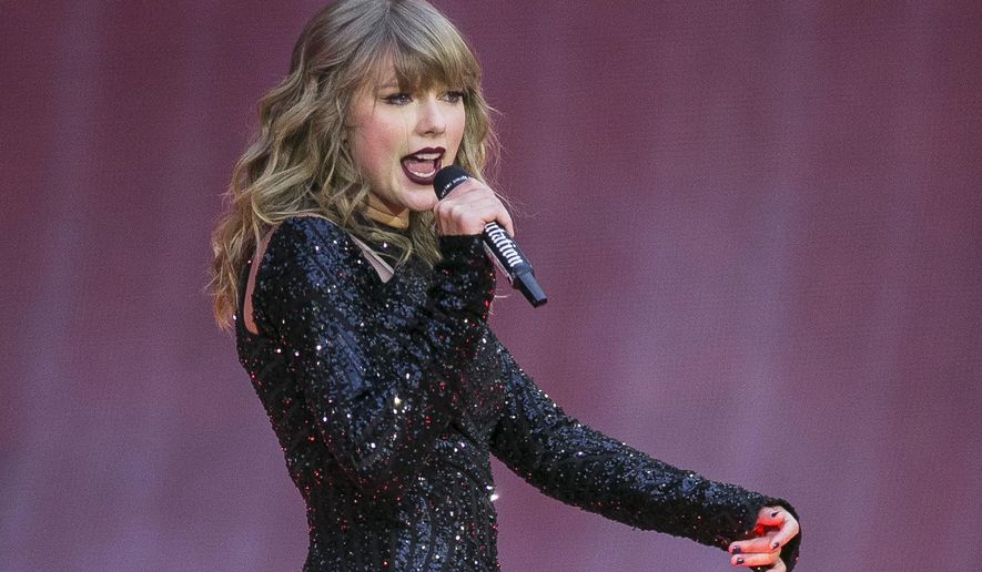 Singer Taylor Swift performs on stage in concert at Wembley Stadium in London. Swift  posted on Instagram Sunday, Oct. 7, that she's voting for Tennessee's Democratic Senate candidate Phil Bredesen, breaking her long-standing refusal to discuss anything politics. (Photo by Joel C Ryan/Invision/AP, File)