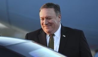 U.S. Secretary of State Mike Pompeo arrives at Osan Air Base in Pyeongtaek, in South Korea, Sunday, Oct. 7, 2018, after his North Korea trip. Pompeo has wrapped up his fourth visit to North Korea after meeting Kim Jong Un to seek elusive progress in efforts to persuade him to give up his nuclear weapons. ( Jung Yeon-je, Pool Photo via AP)