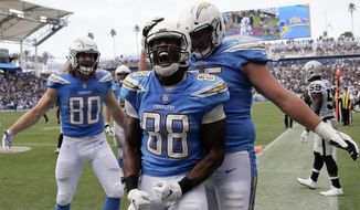 Los Angeles Chargers tight end Virgil Green (88) celebrates his touchdown during the second half of an NFL football game against the Oakland Raiders, Sunday, Oct. 7, 2018, in Carson, Calif. (AP Photo/Jae C. Hong)