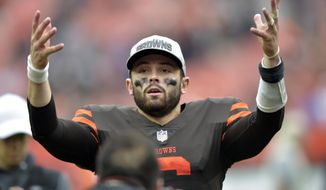 Cleveland Browns quarterback Baker Mayfield celebrates after the team defeated the Baltimore Ravens during overtime in an NFL football game, Sunday, Oct. 7, 2018, in Cleveland. (AP Photo/David Richard)