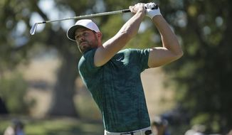 Kevin Tway follows his shot from the seventh tee of the Silverado Resort North Course during the final round of the Safeway Open PGA golf tournament Sunday, Oct. 7, 2018, in Napa, Calif. (AP Photo/Eric Risberg)