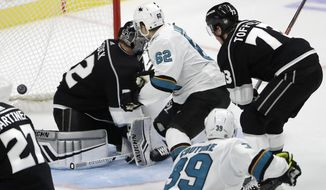 San Jose Sharks' Kevin Labanc (62) scores the game-winning goal past Los Angeles Kings goaltender Jonathan Quick, left, during overtime of an NHL hockey game Friday, Oct. 5, 2018, in Los Angeles. San Jose won 3-2. (AP Photo/Marcio Jose Sanchez)