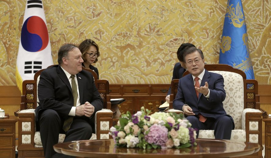 South Korean President Moon Jae-in, right, talks with U.S. Secretary of State Mike Pompeo during a meeting at the presidential Blue House in Seoul, South Korea, Sunday, Oct. 7, 2018. (AP Photo/Ahn Young-joon/Pool)