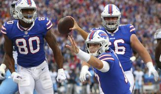 Buffalo Bills quarterback Josh Allen (17) celebrates after scoring a rushing touchdown against the Tennessee Titans during the first half of an NFL football game, Sunday, Oct. 7, 2018, in Orchard Park, N.Y. (AP Photo/Jeffrey T. Barnes)