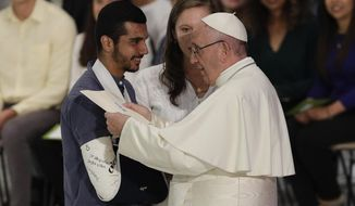 Pope Francis greets faithful at the end of his meeting with youths attending the Synod, at the Vatican, Saturday, Oct. 6, 2018. (AP Photo/Gregorio Borgia)