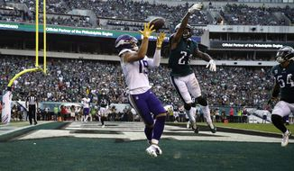 Minnesota Vikings' Adam Thielen (19) catches a touchdown against Philadelphia Eagles' Ronald Darby (21) during the first half of an NFL football game, Sunday, Oct. 7, 2018, in Philadelphia. (AP Photo/Matt Rourke)