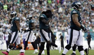 Philadelphia Eagles' Jay Ajayi walks off the field after fumbling during the second half of an NFL football game against the Minnesota Vikings, Sunday, Oct. 7, 2018, in Philadelphia. (AP Photo/Michael Perez) **FILE**