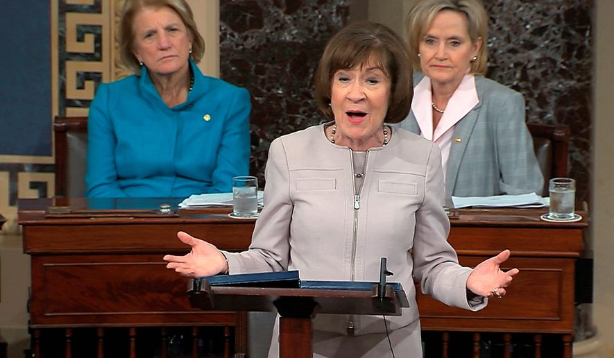 In this image from video provided by Senate TV, Sen. Susan Collins, R-Maine., speaks on the Senate floor about her vote on Supreme Court nominee Judge Brett Kananaugh, Friday, Oct. 5, 2018 in the Capitol in Washington.  Sen Shelly Capito, R-W.Va., sits rear left and Sen. Cindy Hyde-Smith, R-Miss., sits right.  (Senate TV via AP)
