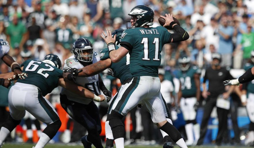 Philadelphia Eagles quarterback Carson Wentz (11) throws a pass against the Tennessee Titans during an NFL football game Sunday, Sept. 30, 2018, in Nashville, Tenn. (Jeff Haynes/AP Images for Panini) **FILE**
