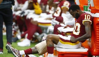 Washington Redskins wide receiver Paul Richardson (10) sits on the sideline in the second half of an NFL football game against the Washington Redskins in New Orleans, Monday, Oct. 8, 2018. The Saints won 43-19. (AP Photo/Butch Dill) **FILE**