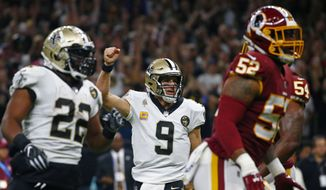 New Orleans Saints quarterback Drew Brees (9) reacts after throwing a touchdown pass in the first half of an NFL football game in New Orleans, Monday, Oct. 8, 2018. (AP Photo/Butch Dill)