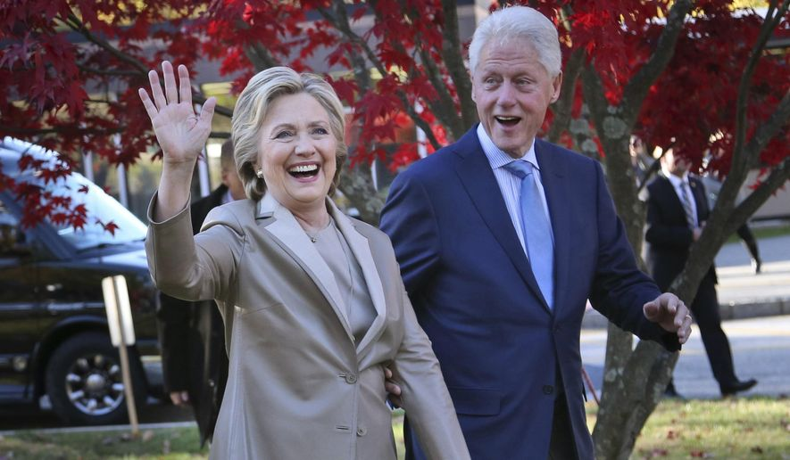 """In this Nov. 8, 2016, file photo, Democratic presidential candidate Hillary Clinton, and her husband former President Bill Clinton, greet supporters after voting in Chappaqua, N.Y. The Clintons announced Monday, Oct. 8, 2018, they will visit four cities in 2018 and nine in 2019 across North America in a series of conversations dubbed """"An Evening with President Bill Clinton and former Secretary of State Hillary Rodham Clinton."""" (AP Photo/Seth Wenig, File)"""