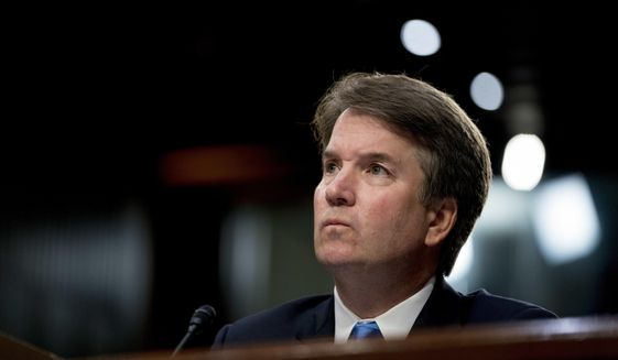 Then Supreme Court nominee, Judge Brett Kavanaugh, pauses while testifying before the Senate Judiciary Committee on Capitol Hill in Washington, Sept. 5, 2018. The judge's confirmation is a flashpoint for the November midterms. (AP Photo/Andrew Harnik) ** FILE **
