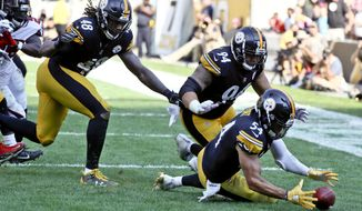 Pittsburgh Steelers linebacker L.J. Fort (54) recovers a fumble by Atlanta Falcons quarterback Matt Ryan for a touchdown in the fourth quarter of an NFL football game, Sunday, Oct. 7, 2018, in Pittsburgh. (AP Photo/Gene J. Puskar)