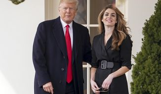 FILE - In this March 29, 2018, file photo, President Donald Trump poses for members of the media with then  White House Communications Director Hope Hicks on her last day before he boards Marine One on the South Lawn of the White House in Washington. Hicks is taking on a similar role at the new Fox company, meaning she'll supervise messaging at her former boss' favorite television network. (AP Photo/Andrew Harnik, File)