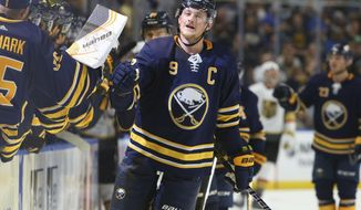 Buffalo Sabres forward Jack Eichel (9) celebrates his goal during the first period of an NHL hockey game against the Vegas Golden Knights, Monday, Oct. 8, 2018, in Buffalo N.Y. (AP Photo/Jeffrey T. Barnes)