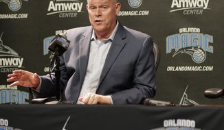 """FILE - In this May 30, 2018, file photo, Orlando Magic head coach Steve Clifford answers questions at an NBA basketball news conference, in Orlando, Fla. His father was a teacher and a high school coach in a tiny town in northern Vermont, and when he was a sophomore on his dad's team Clifford was telling his parents that he intended to head down that very same career path. The NBA was not on his radar. """"Never,"""" Clifford said. """"Not at all.""""(AP Photo/John Raoux, File)"""