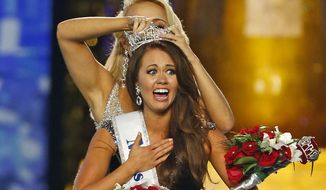 In this Sept. 10, 2017, file photo, Miss North Dakota Cara Mund reacts after being named Miss America during the Miss America 2018 pageant in Atlantic City, N.J.  (AP Photo/Noah K. Murray, File)