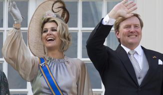 In this Tuesday, Sept. 18, 2018, image Dutch King Willem-Alexander and Queen Maxima wave from the balcony of royal palace Noordeinde in The Hague, Netherlands, Tuesday, Sept. 18, 2018. The king and queen of the Netherlands will travel to Britain later this month on a state visit that the Dutch government says underscores the two countries' close links. (AP Photo/Peter Dejong)