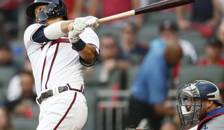 Atlanta Braves' Kurt Suzuki (24) hits a 2 RBI single against the Los Angeles Dodgers during the fourth inning in Game 4 of baseball's National League Division Series, Monday, Oct. 8, 2018, in Atlanta. (AP Photo/John Bazemore) ** FILE **