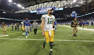 Green Bay Packers quarterback Aaron Rodgers walks off the field after an NFL football game against the Detroit Lions, Sunday, Oct. 7, 2018, in Detroit. The Lions won 31-23. (AP Photo/Rey Del Rio)