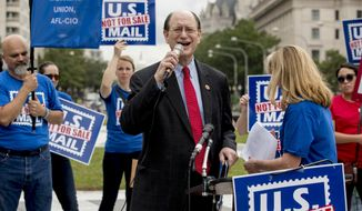 Rep. Brad Sherman, D-Calif., speaks at a rally to oppose a plan by the White House's Office of Management and Budget to sell off the U.S. Postal Service to corporate interests, at Freedom Plaza, Monday, Oct. 8, 2018, in Washington. (AP Photo/Andrew Harnik)