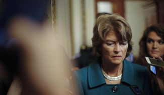 Sen. Lisa Murkowski, R-Alaska, pauses while speakings to members of the media after a vote to advance Brett Kavanaugh's nomination to the Supreme Court, on Capitol Hill. (AP Photo/Pablo Martinez Monsivais, File)