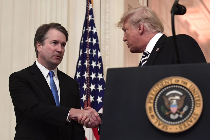 President Donald Trump, right, shakes hands with Supreme Court Justice Brett Kavanaugh, left, before a ceremonial swearing in in the East Room of the White House in Washington, Monday, Oct. 8, 2018. (AP Photo/Susan Walsh) **FILE**