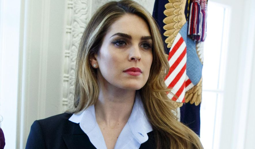 In this Feb. 9, 2018, file photo, White House Communications Director Hope Hicks appears in the Oval Office at the White House in Washington. (AP Photo/Evan Vucci, FIle)