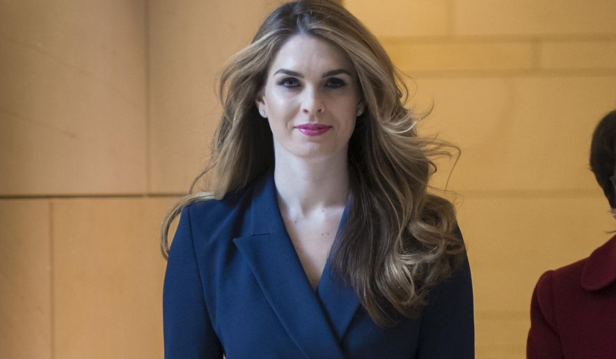 FILE - In this Feb. 27, 2018 photo, White House Communications Director Hope Hicks, one of President Trump's closest aides and advisers, arrives to meet behind closed doors with the House Intelligence Committee, at the Capitol in Washington. Hicks has been hired at the new Fox company being created by the shedding of many of 21st Century Fox's entertainment assets to the Walt Disney Co. Hicks, who left the White House on March 29, will be based in Los Angeles. (AP Photo/J. Scott Applewhite, File)