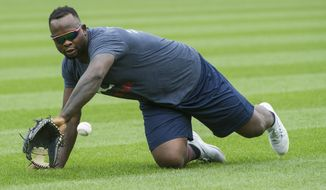 FILE - In this Aug. 30, 2018 file photo, Minnesota Twins' Miguel Sano warms up before a baseball game, in Cleveland, Ohio.  Sano was under investigation Monday, Oct. 8, 2018, in the Dominican Republic after authorities detained the third baseman following a traffic incident that injured a police officer. (AP Photo/Phil Long, File)