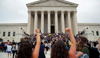 Activists protest on the steps and plaza of the Supreme Court after the confirmation vote of Brett M. Kavanaugh on Capitol Hill, on Saturday. (Associated Press)