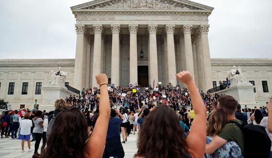 Activists protest on the steps and plaza of the Supreme Court after the confirmation vote of Supreme Court nominee Brett Kavanaugh, on Capitol Hill, Saturday, Oct. 6, 2018 in Washington. (AP Photo/Alex Brandon) ** FILE **
