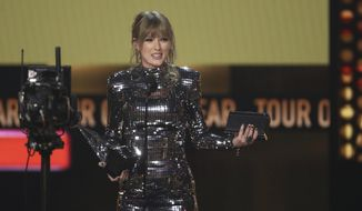 Taylor Swift accepts the award for tour of the year at the American Music Awards on Tuesday, Oct. 9, 2018, at the Microsoft Theater in Los Angeles. (Photo by Matt Sayles/Invision/AP) ** FILE **