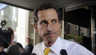 In this July 24, 2013, file photo, former New York Rep. Anthony Weiner leaves his apartment building in New York. (AP Photo/Richard Drew, File)